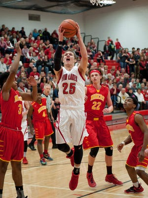 Sectional basketball - Twin Lakes vs Andrean. Blake Bennington gets to the rim.   By Jerry Schultheiss for Journal & Courier.