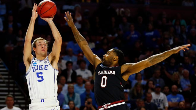 Duke Blue Devils guard Luke Kennard (5) shoots the ball against South Carolina Gamecocks guard Sindarius Thornwell (0) during the first half in the second round of the 2017 NCAA Tournament at Bon Secours Wellness Arena on March 19.