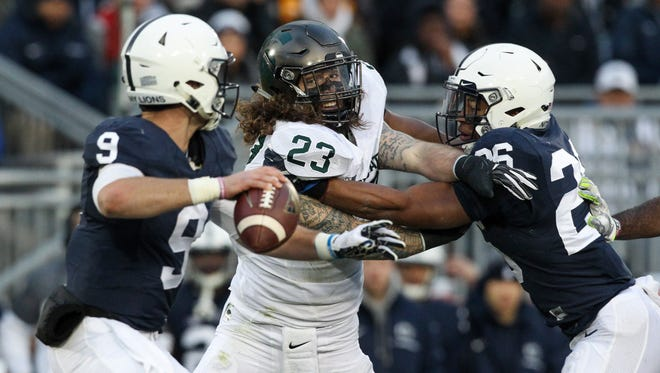 Nov 26, 2016; University Park, PA, USA; Michigan State Spartans linebacker Chris Frey (23) pressures Penn State Nittany Lions quarterback Trace McSorley (9) during the first quarter at Beaver Stadium. Penn State defeated Michigan State 45-12.