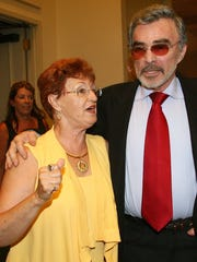 Sue Hall, longtime secretary to Bobby Bowden, walks with legendary Hollywood actor and former FSU football player Burt Reynolds into the Bobby Bowden Roast Wednesday July 15, 2009 at the University Center Club in Tallahassee, Fla. The roast was sponsored by the Tallahassee Quarterback Club.