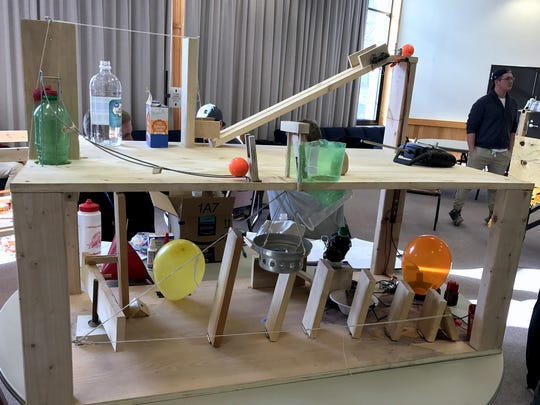 This elaborate contraption is one of several machines designed by Corning Community College engineering students with the goal of bursting balloons in as many steps as possible.