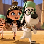 """Sherman, voiced by Max Charles, left, and Mr. Peabody, voiced by Ty Burell, appear in a scene from """"Mr Peabody & Sherman."""""""