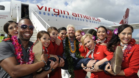 Virgin Group's Richard Branson poses with employees
