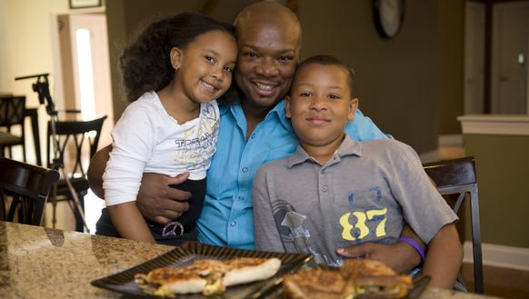 Aaron McCargo,  shown here with his son Justin  and