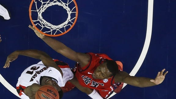 Georgia forward Brandon Morris (31) drives on Mississippi center Dwight Coleby (23) during the first half of an NCAA college basketball game in the quarterfinal round of the Southeastern Conference men's tournament, Friday, March 14, 2014, in Atlanta. (AP Photo/John Bazemore)
