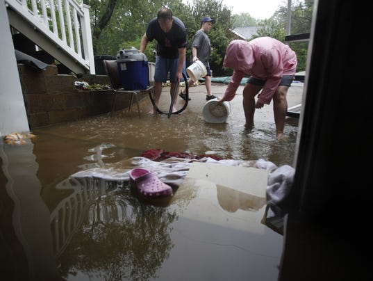 Record-breaking flood displaces thousands