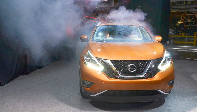 Nissan Canton employees make a grand entrance in the new Nissan Murano at the Canton facility in Madison County.