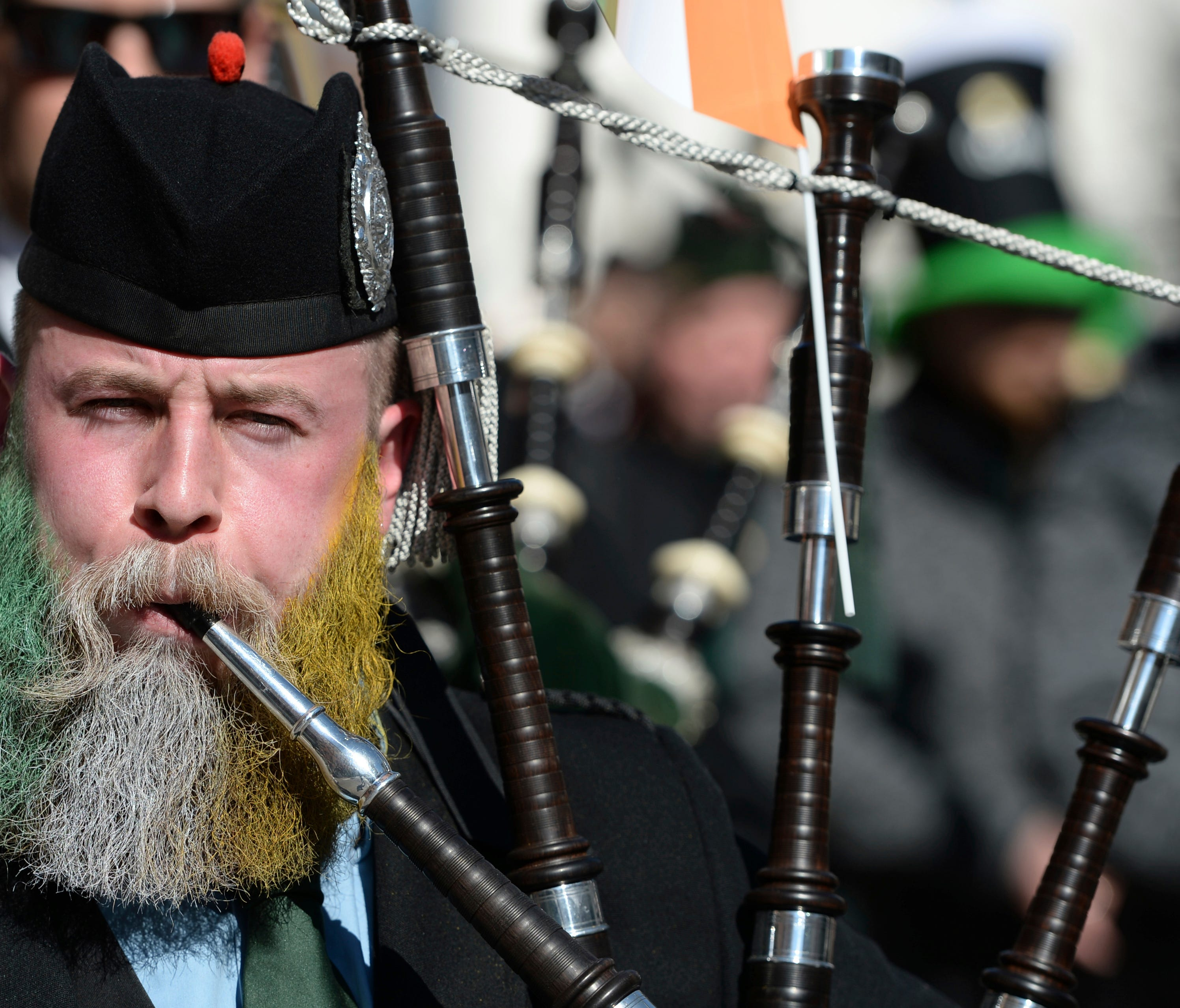 A bagpipe player, with a beard in the colors of the Irish national flag, plays during the St. Patrick's Day Parade in Munich, Germany on Sunday.