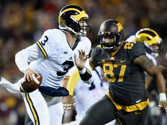Wilton Speight scrambles away from Minnesota's Gaelin