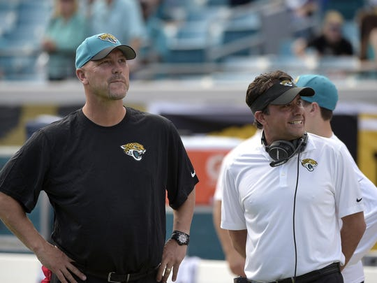 FILE - In this Nov. 30, 2014, file photo, Jacksonville Jaguars head coach Gus Bradley, left, and offensive coordinator Jedd Fisch watch from the sideline prior to an NFL football game against the New York Giants in Jacksonville, Fla. Bradley fired Fisch on Tuesday,Dec. 30, 2014, two days after Jacksonville ended the season with an NFL-low 24 offensive touchdowns. (AP Photo/Phelan M. Ebenhack, File)
