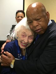 Jerry Emmett hugs U.S. Rep John Lewis at the Democratic National Convention in Philadelphia, Pa.