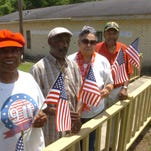 Dorothy Thomas, Richard Pollard, Betty Thomas and John Thomas prepare for the Fourth of July open house at the Veterans Activities Center in Opelousas.