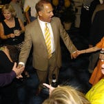 Above: LSU head football coach Les Miles visits with guests during the LSU Tiger Tour event at the Horseshoe Casino River Dome.