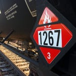 A warning placard is attached to a tank car carrying crude oil near a loading terminal in Trenton, N.D., on Nov. 6, 2013.