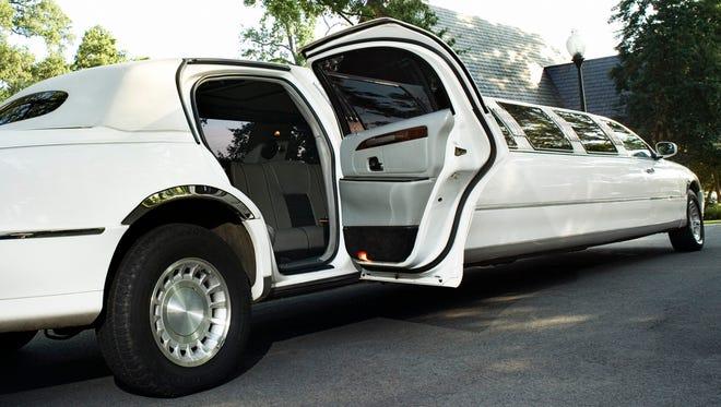 Limousine with open door.