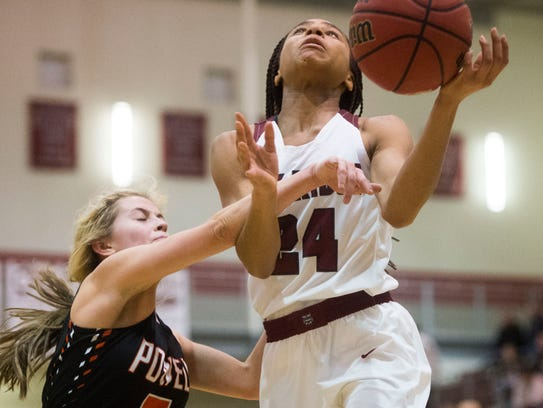 Oak Ridge's Jada Guinn (24) goes up for a shot as Powell's