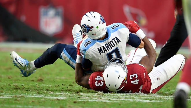 Titans quarterback Marcus Mariota (8) is sacked during the fourth quarter Sunday.