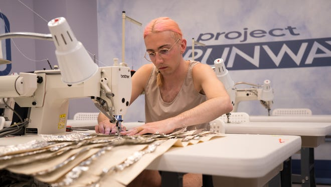 "Sevierville's Aaron Myers works while on ""Project Runway."""