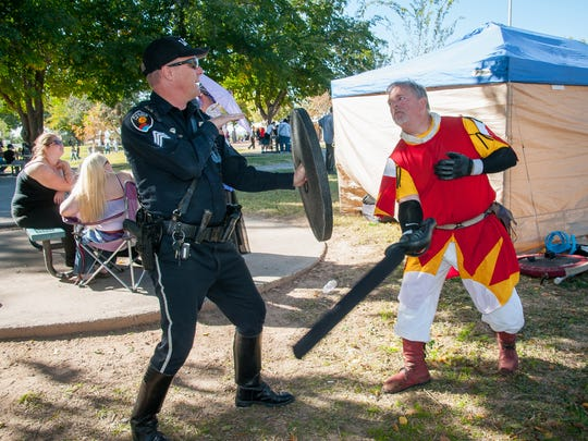 Las Cruces Police Sgt. Robert Elrick, left practices some fighting moves with Daniel Kitka during the 44th annual Renaissance ArtsFaire at Young Park on Saturday.