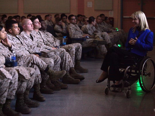 Professional speaker Kelly Narowski, who was paralyzed from the chest down during a car accident in 1998, leads a safety briefing at the Marine Corps Air Ground Combat Center in Twentynine Palms on May 16, 2013. Narowski has given more than 180 safety briefings.