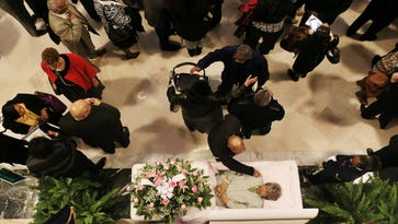 A mourner paid respect to civil rights leader and former Kentucky State Sen. Georgia Davis Powers as she was remembered in the Capitol rotunda in Frankfort.