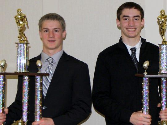 Joel Stephens Award winners Peyton Miller of Waverly, left, and Gabe Enicks of Corning with their trophies Thursday at the Holiday Inn-Riverview in Elmira.