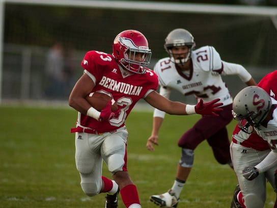 Bermudian Springs' Briton Shelton keeps Shippensburg defenders at bay while running the ball on Friday night Sept. 12, 2014 at Bermudian Springs High School. Shane Dunlap - GameTimePA