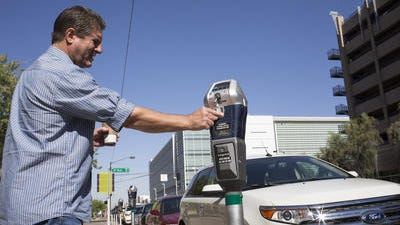 Some people are paying more for parking in downtown Phoenix... but some aren't paying anything