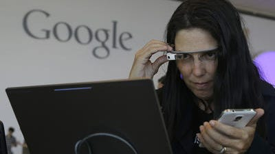 Cecilia Abadie, founder of 33 Labs, uses a pair of Google Glass as she registers for Google I/O 2014 at the Moscone Center in San Francisco, Tuesday, June 24, 2014. Google Glass is slowly becoming more common in sports as teams and broadcasters try to bring fans closer to the action.