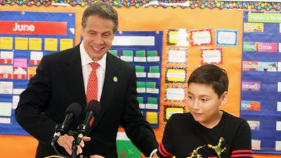 Gov. Andrew Cuomo is introduced by fifth grader Esteban Pauta at Hillcrest Elementary School in Peekskill on Thursday. Cuomo was at the school to announce a $500,000 three-year grant to the district to enhance social service programs for kids.