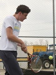 Watkins Memorial senior Braden Clear practices his backhand during a practice this season. Braden and his brother Bryce won two matches in doubles competition during the Division I sectional tournament.