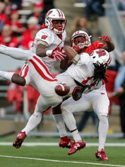Wisconsin corner back Derrick Tindal (left) and safety