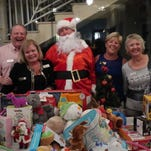 Social Scene: Yacht Club party benefits Toys for Tots