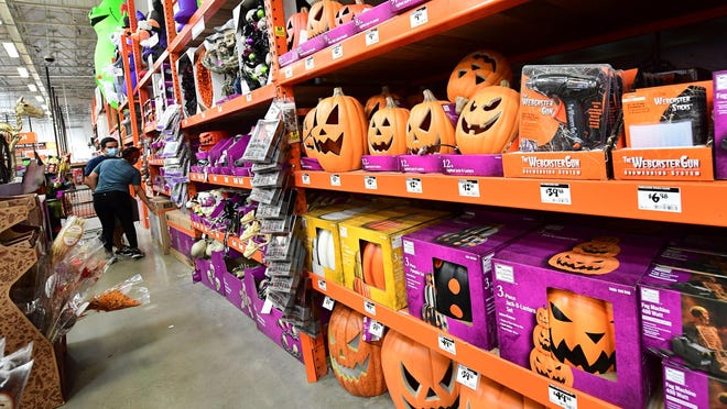People shop for Halloween items at a home improvement retailer store in Alhambra, California on Sept.  9, 2020.