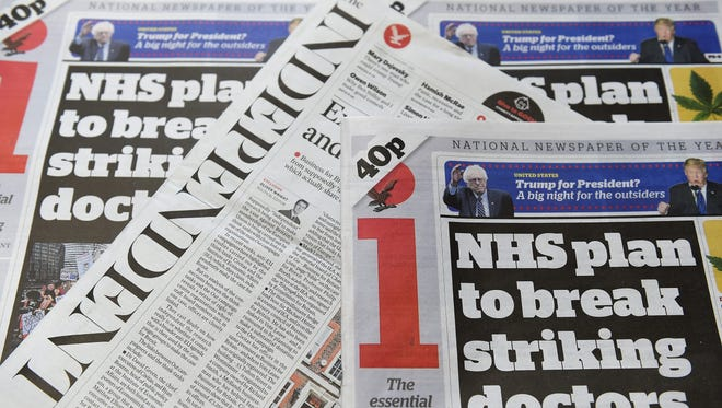 British national newspapers, 'The Independent' and 'The Independent's' 'i' print editions at a store in London, Britain, Feb. 11, 2016.