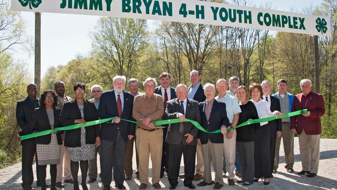 Mississippi State University Extension Service 4-H representatives, state and local officials, and industry representatives enjoy a beautiful day for a ribbon-cutting ceremony for the Jimmy Bryan 4-H Youth Complex in West Point April 10, 2014.