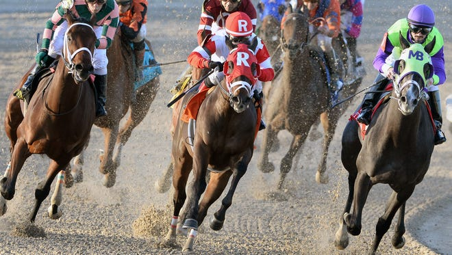 Rosie Napravnik (red silks) guides  Vicar's In Trouble to win the Grade III Lecomte Stakes in January. Vicar's in Trouble also won the Grade 1 Louisiana Derby Saturday.