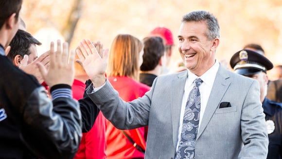 Ohio State Buckeyes head coach Urban Meyer greets fans