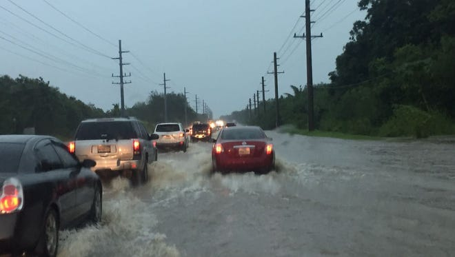 Northbound traffic was backed up on a flooded stretch of Marine Corps Drive Friday morning by Polaris Point.