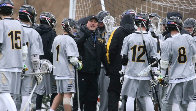 Head Coach Jack Beaney gathers the Honeoye Falls-Lima Lacrosse team for a timeout.