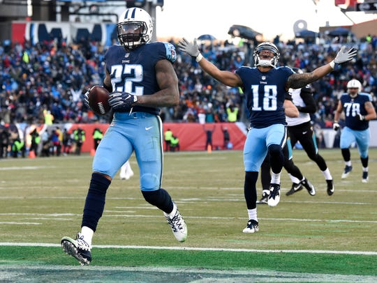 Titans running back Derrick Henry (22) scores on a