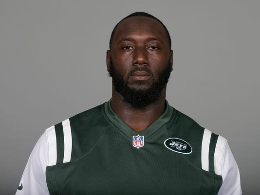 FILE -This is a 2017 file photo showing Muhammad Wilkerson of the New York Jets NFL football team. The Jets have released defensive end Muhammad Wilkerson, ending the one-time Pro Bowl selection's stint with the team that drafted him in the first round in 2011. The team made the long-anticipated move on Wednesday, Feb. 28, 2018, clearing $11 million in salary cap space. (AP Photo/File)