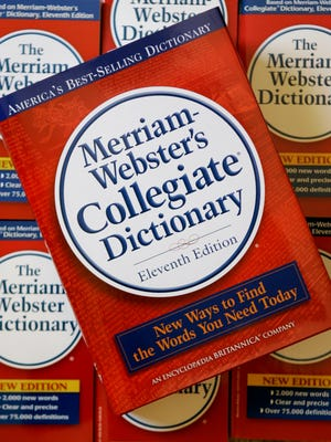 The eleventh edition of Merriam-Webster's Collegiate Dictionary is seen stacked on other dictionaries at the company's headquarters in Springfield, Mass., Tuesday, July 3, 2007.    (AP Photo/Charles Krupa)