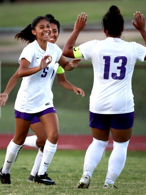 Smyrna's Amy Sanchez (5) celebrates her first of 2 goals in a row with teammate Brenda Cernas (13) during the match against La Vergne on Tuesday, Aug. 28, 2018, in La Vergne.
