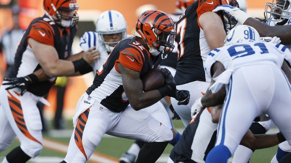 Cincinnati Bengals running back Jeremy Hill (32) runs the ball during their preseason game against the Indianapolis Colts at Paul Brown Stadium.