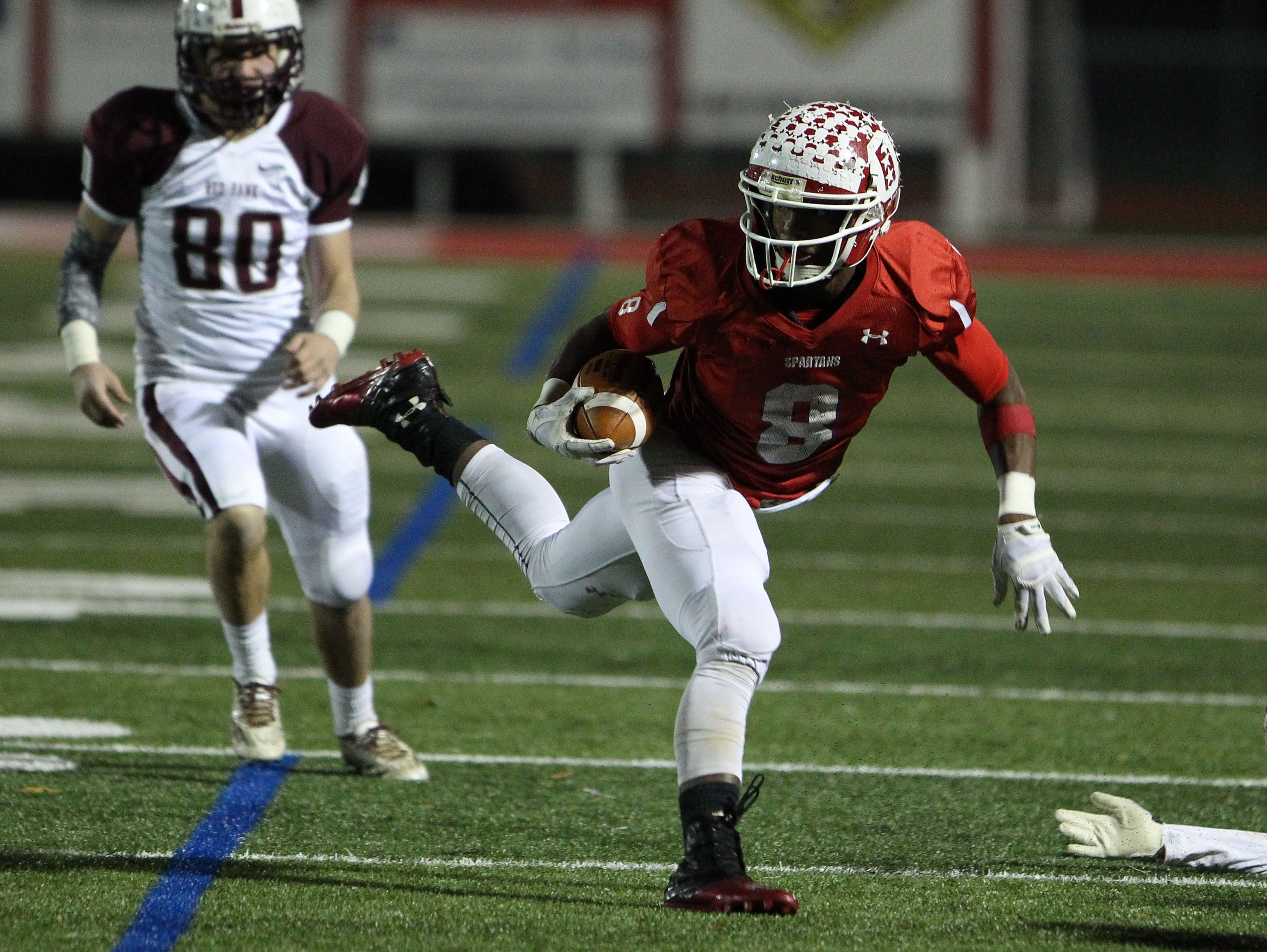 Ocean's Tyler Thompson (8) carries the ball against Red Bank earlier this season.