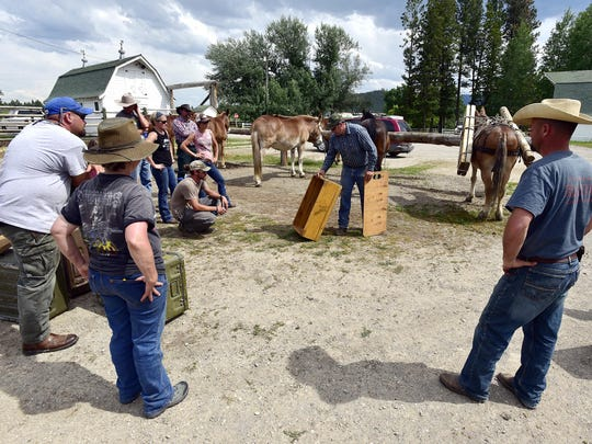 Casey Burns shows the class some of the equipment that