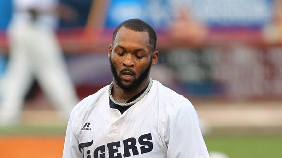 """Jackson State's Charles Tillery takes off his helmet after being tagged out in a run-down between first and second bases during an NCAA Baseball Division I Regional Tournament game against Mississippi State Saturday, May 31, 2014, at M.L. """"Tigue"""" Moore Field in Lafayette, La."""