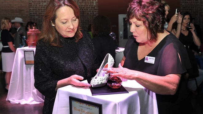 Texas First Lady Cecilia Abbott, left, and Jackie Hamm, CEO of The Kitchen, look over one of several entries in a shoe decorating contest at the High Heels for Hot Meals event in 2016. The event is a fundraiser for Meals on Wheels. It will return to The Forum May 11.