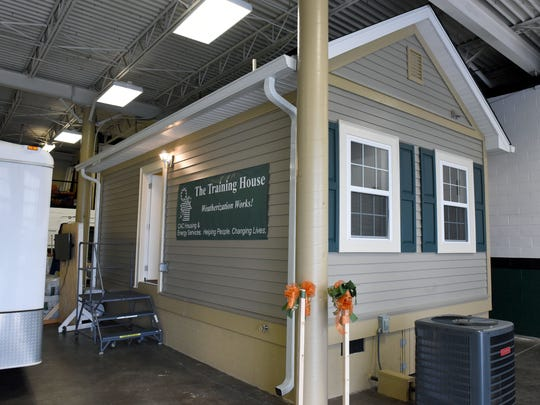 A small model house demonstrating weatherization techniques at the CAC office in L.T. Ross Building on Wednesday, Nov. 8, 2017. The house is used to do community demonstrations.